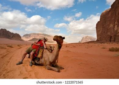 man on camel in jordan