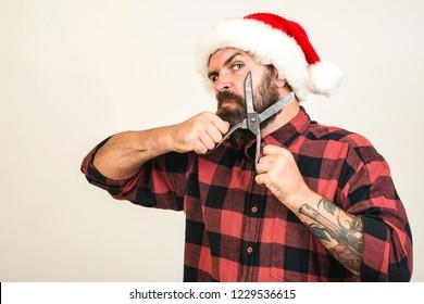 Man on christmas. Man celebrating isolated. Hipster santa claus. Christmas barber. Santa claus shaving.