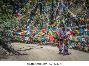 Man on a cycle touring trip in Yunnan Province, China