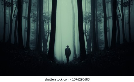 man on dark scary forest road, surreal landscape