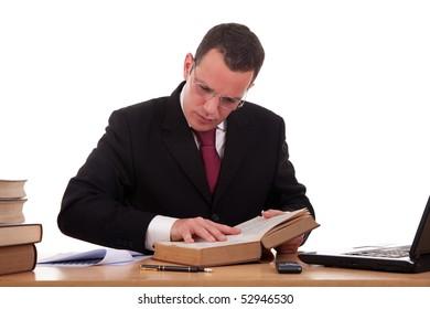 man on desk reading and studying, isolated on white background, studio shot.