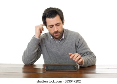 man on a desk working with a tablet pc, isolated