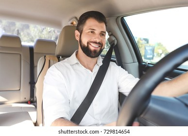 Man on driver's seat of car