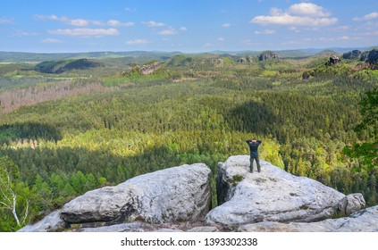 Man on the edge of rock