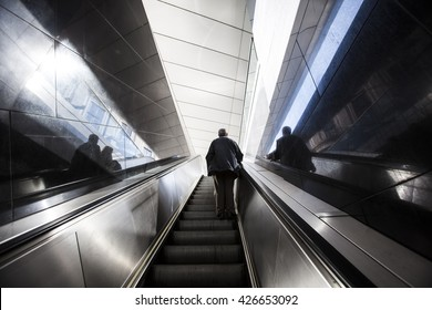 man on the escalator stairs going up