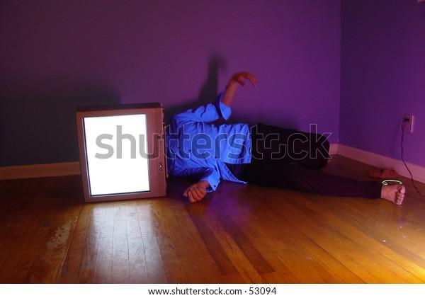 man on ground with tv