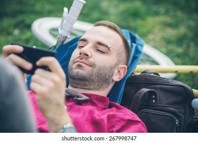 Man on his bike using smartphone