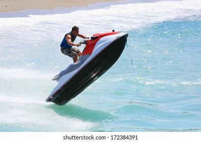 man on jet ski jump on the wave