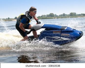 Man on jet ski rides very close