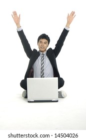 Man on a laptop computer celebrating his success on the internet isolated over a white background