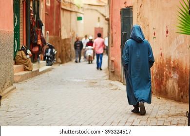 Man on Moroccan market (souk) in Marrakech, Morocco