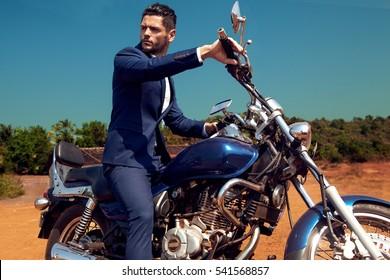 Man on motorcycle in suite