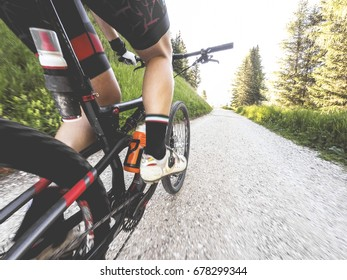 Man on mountain bike on single trail. Original point of view. Close up of