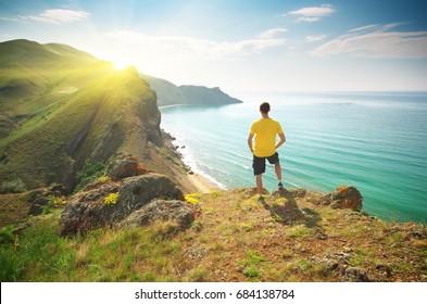 Man on mountain cliff. Conceptual design.