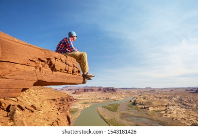 Man on the mountains cliff. Hiking scene.