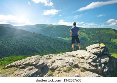 Man on peak of mountain. Emotional scene.