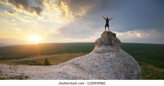 Man on peak of mountain. Nature and conceptual composition.