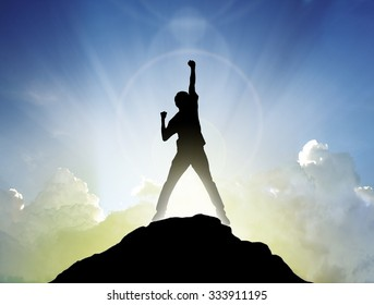 Man on the peak of mountain and sunlight  , success winner business concept