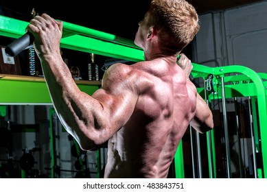 Man on pull up bar exercising