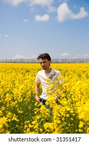 man on the rapeseed field