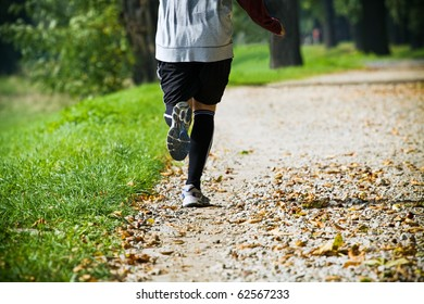 Man on recreation running in city park
