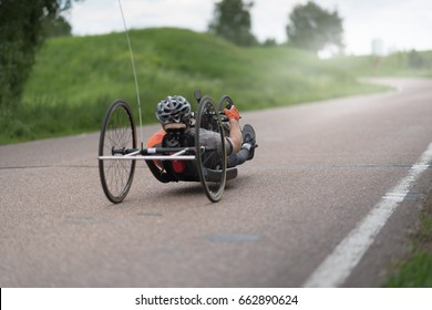 man on recumbent bicycles on a asphalt road.