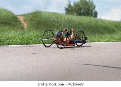 man on recumbent bicycles on a asphalt road