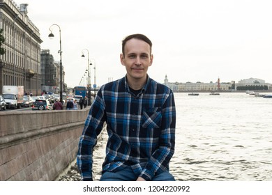 The man on the river embankment