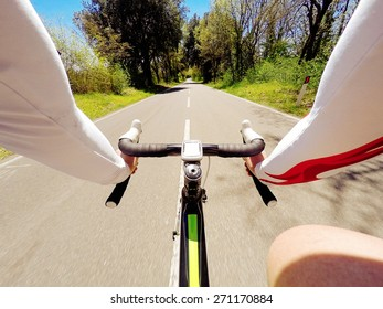 man on road bike in a tuscany landscape. POV, Original Point of View.