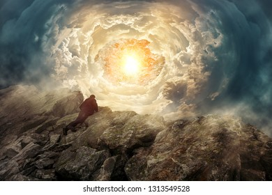 Man on a rock looks into a surreal universe