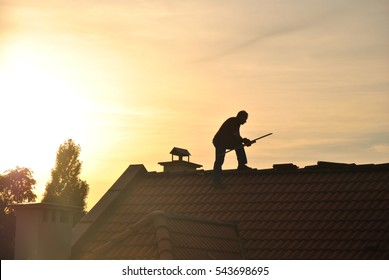 Man on a roof