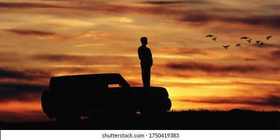 a man on the roof of the car sunset evening in bali, notably Nusa Penida, indonesia - 13 Mar 2020