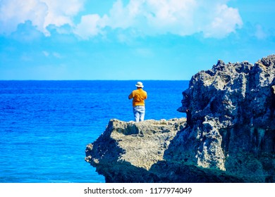Man on a sea rock