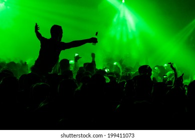 Man on shoulders in nightclub party rave silhouette