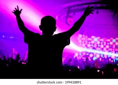 Man on shoulders in nightclub party silhouette