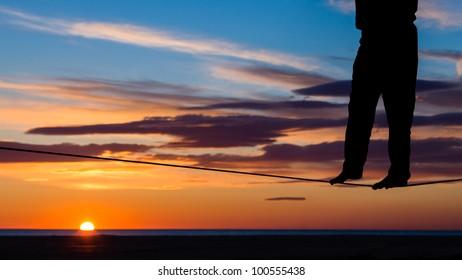 man on a slckline in sunrise