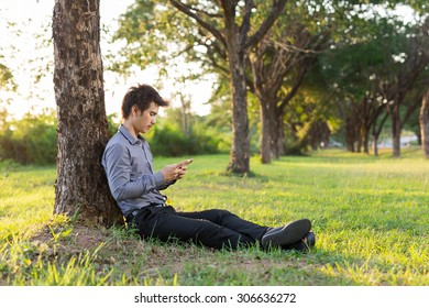 Man on smart phone - Young business man on smart phone in the park,He is relax.