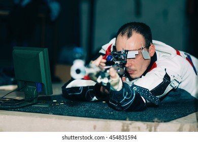 Man on sport shooting training practicing for competition with free rifle