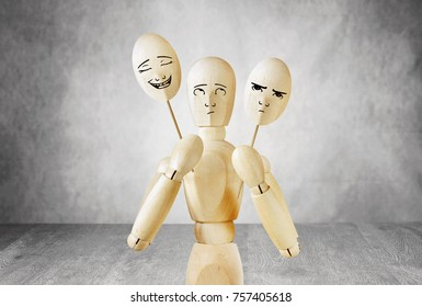 Man on stage can not choose a cheerful or sad mask