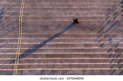 Man on the stairs, aerial photography, picture with drones