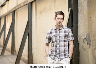 Man on the street in check shirt