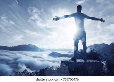Man on a summit over an ocean of clouds