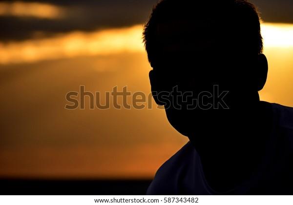 A man on sunrise background