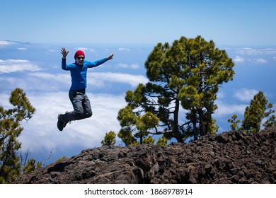 man on the top of the hill above clouds with view on canary islands