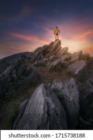 Man on top mountain win concept, Traveler hiking at nature
