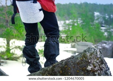 Man on top of a rock in hiking equipment