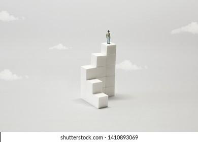 man on the top of white minimal geometric futuristic building