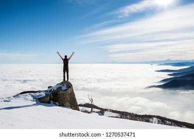 Man on the top of the world, italian Alps. Italy