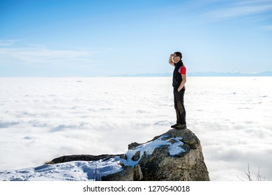 man on the top of the world scanning the horizon