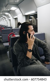 Man on the train on the phone